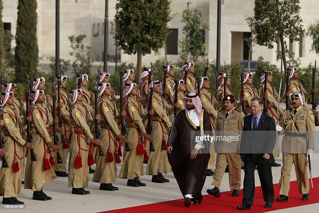 Jordan's Prince Faisal bin Al-Hussein (front R), and Saudi Arabia's Deputy Crown Prince Mohammed bin Salman (front L), review Bedouin honour guards upon their arrival to meet Jordan's King Abdullah at the Royal Palace on August 4, 2015 in Amman, Jordan.