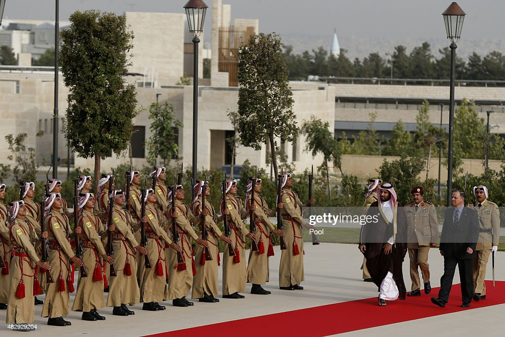 Jordan's Prince Faisal bin Al-Hussein (2nd R), and Saudi Arabia's Deputy Crown Prince Mohammed bin Salman (4nd R), review Bedouin honour guards upon their arrival to meet Jordan's King Abdullah at the Royal Palace on August 4, 2015 in Amman, Jordan.
