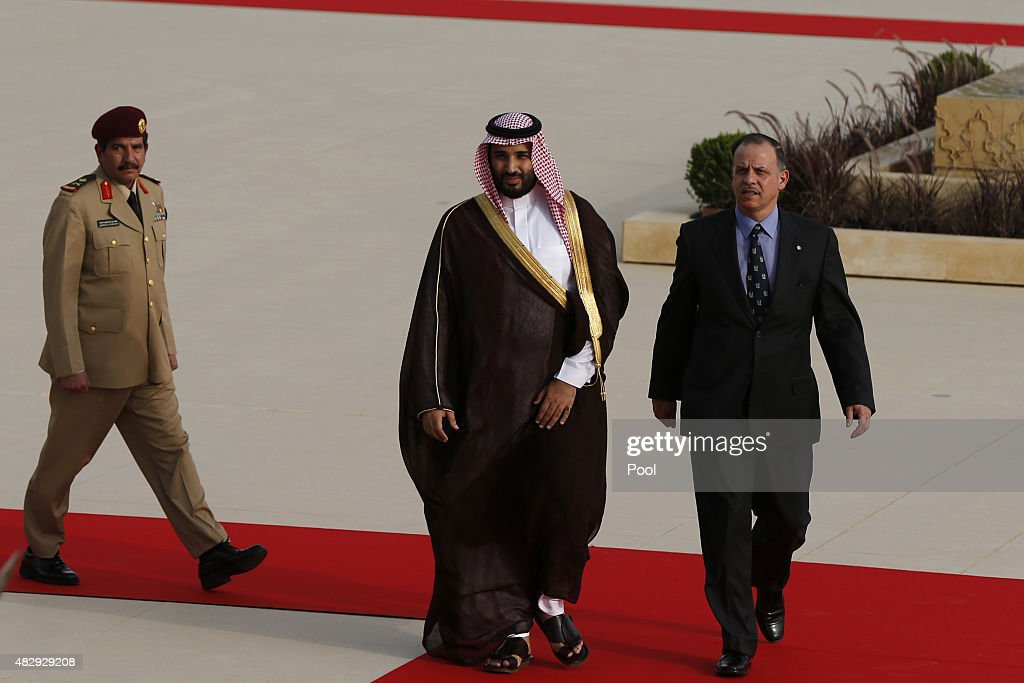 Jordan's Prince Faisal bin Al-Hussein (R), and Saudi Arabia's Deputy Crown Prince Mohammed bin Salman (C), walk upon their arrival to meet Jordan's King Abdullah at the Royal Palace on August 4, 2015 in Amman, Jordan.