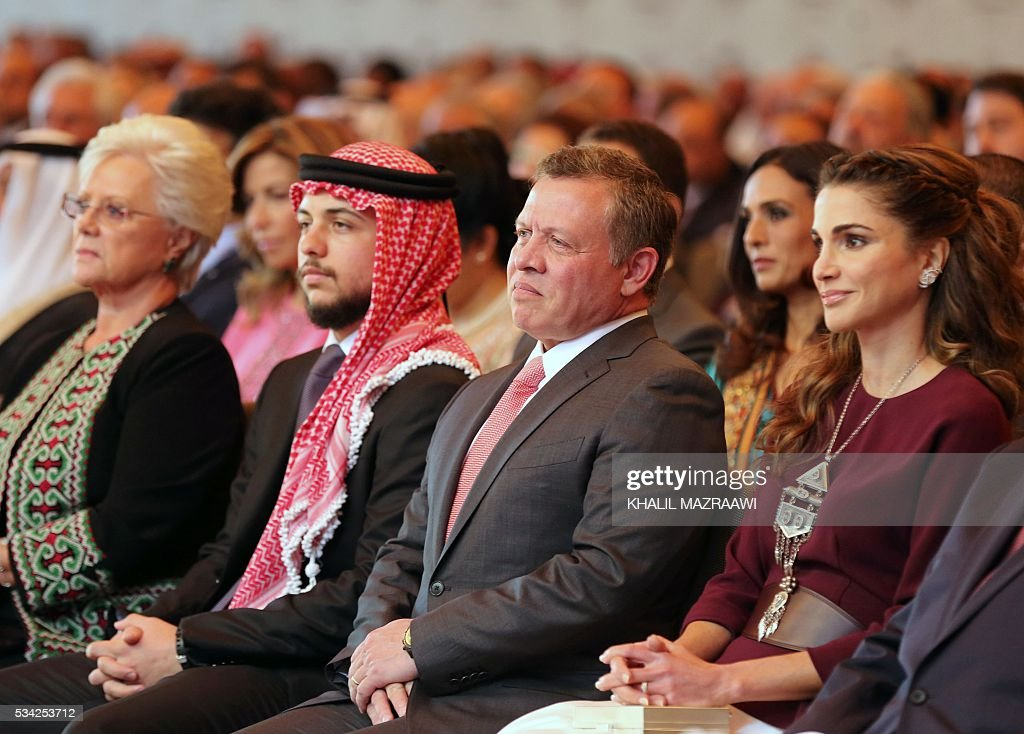 Jordan's Princess Muna, Crown Prince Hussein, King Abdullah II and Queen Rania attend a ceremony held in Amman on May 25, 2016, to mark the desert kingdom's 70th Independence Day. / AFP / POOL / KHALIL