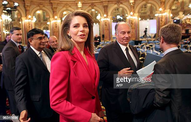 Jordan's Queen Noor and Prince Karim Aga Khan IV arrive to attend the opening day of the Global Zero a summit to put a halt to all nuclear weapons on...