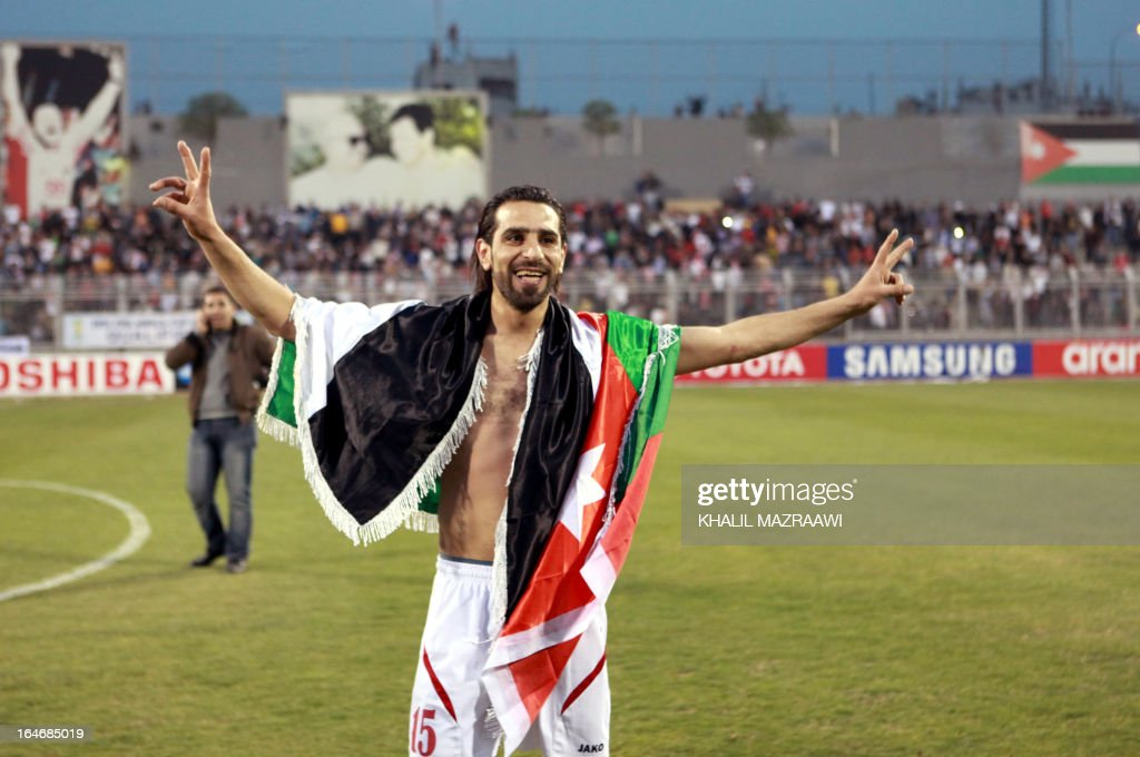 Jordan's Shadi Abu-Hashhash (15) celebrates after Jordan beat Japan 2-1 following their FIFA World Cup Group B Asian qualifiers round four football match, in Amman, on March 26, 2013. AFP PHOTO/KHALIL MAZRAAWI