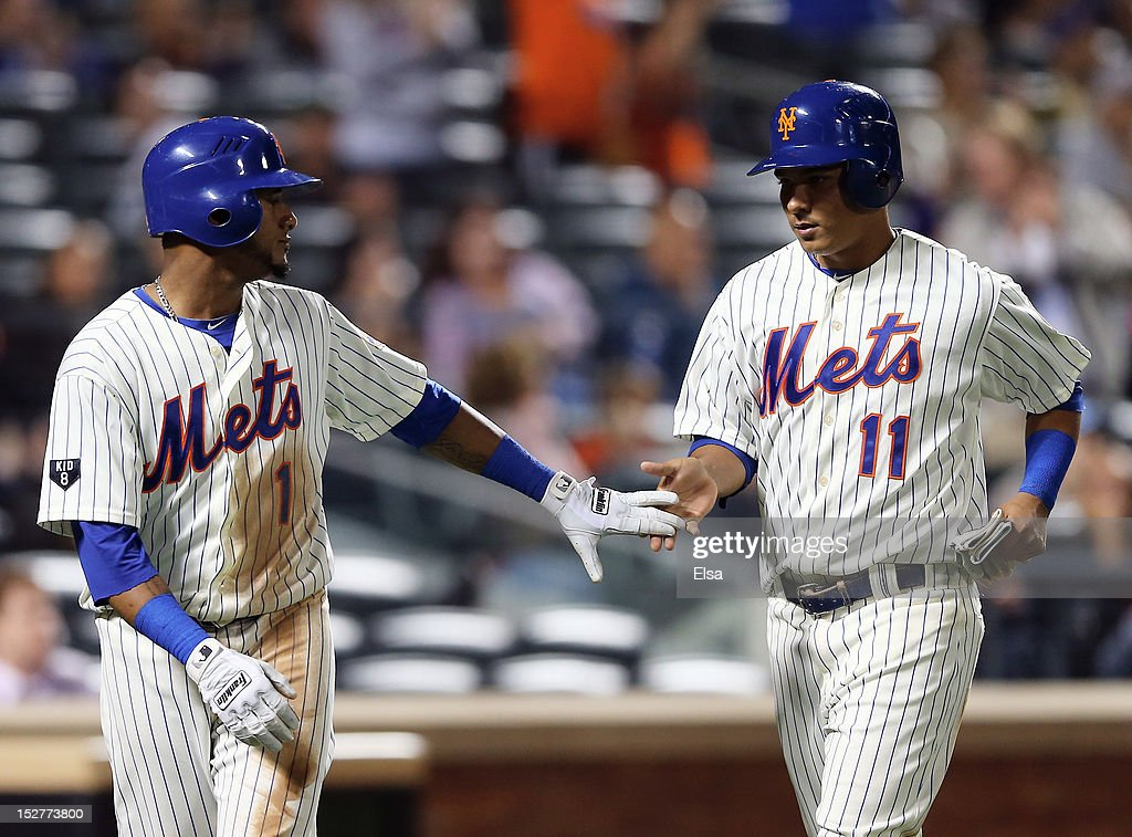 Jordany Valdespin #1 and <a gi-track='captionPersonalityLinkClicked' href=/galleries/search?phrase=Ruben+Tejada&family=editorial&specificpeople=5754705 ng-click='$event.stopPropagation()'>Ruben Tejada</a> #11 of the New York Mets celebrate after they scored off a hit by teammate David Wright in the seventh inning against the Pittsburgh Pirates on September 25, 2012 at Citi Field in the Flushing neighborhood of the Queens borough of New York City.