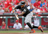 Jordany Valdespin of the Miami Marlins lays down a bunt during the first inning against the Cincinnati Reds at Great American Ball Park on August 8...