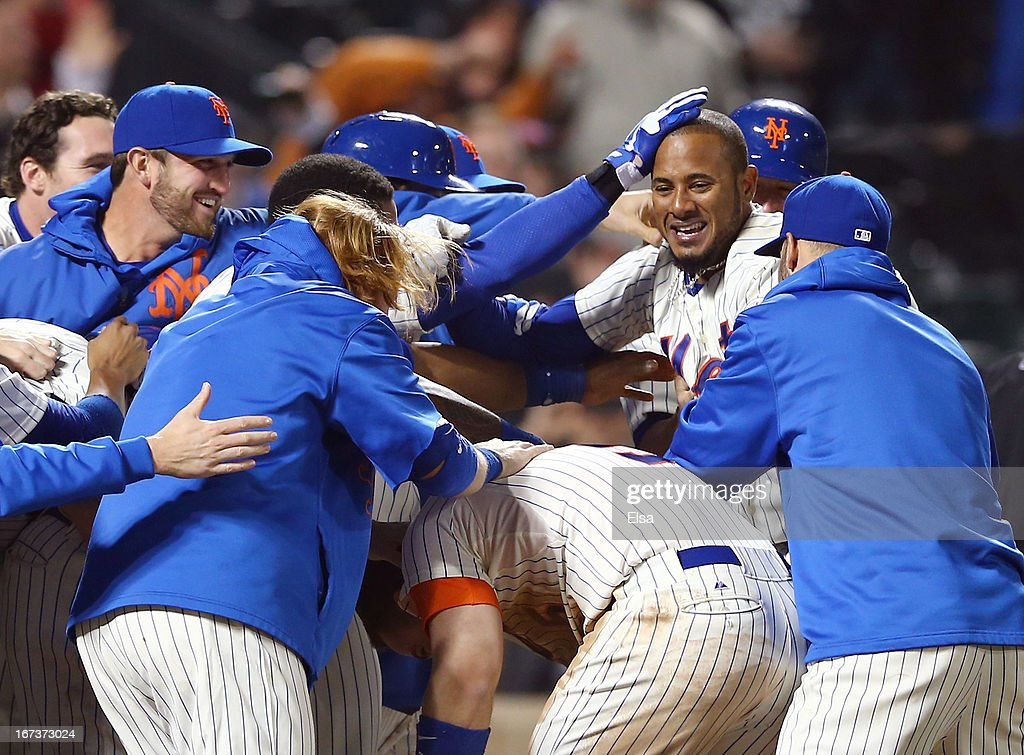 Jordany Valdespin #1 of the New York Mets celebrates his game winning grand slam with teammates in the 10th inning against the Los Angeles Dodgers on April 24, 2013 at Citi Field in the Flushing neighborhood of the Queens borough of New York City. The New York Mets defeated the Los Angeles Dodgers 7-3 in 10 innings.