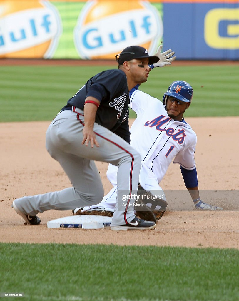 Jordany Valdespin #1 of the New York Mets steals third base in the 10th inning against the Atlanta Braves at Citi Field on September 9, 2012 in the Flushing neighborhood of the Queens borough of New York City.