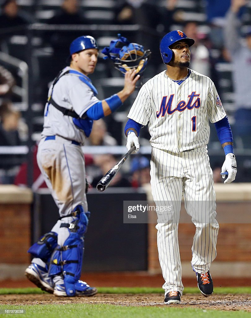 Jordany Valdespin #1 of the New York Mets watches his walk off grand slam in the bottom of the 10th inning as catcher A.J. Ellis #17 of the Los Angeles Dodgers walks off the field on April 24, 2013 at Citi Field in the Flushing neighborhood of the Queens borough of New York City. The New York Mets defeated the Los Angeles Dodgers 7-3 in 10 innings.