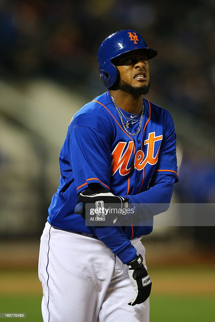Jordany Valdespin #1 of the New York Mets winces after landing awkwardly on his elbow on a pick off attempt against the Miami Marlins during their game on April 5, 2013 at Citi Field in the Flushing neighborhood of the Queens borough of New York City.