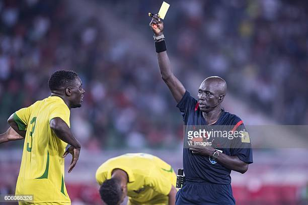 Jordao Encarnacao Tackey Diogo of Sao Tome e Principe gets a yellow card from referee M Fidel Gomes during the Africa Cup of Nations match between...