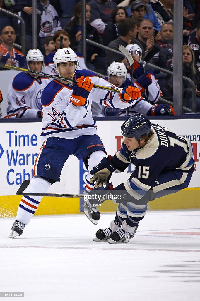 Jorden Eberle #14 of the Edmonton Oilers checks <a gi-track='captionPersonalityLinkClicked' href=/galleries/search?phrase=Derek+Dorsett&family=editorial&specificpeople=4306277 ng-click='$event.stopPropagation()'>Derek Dorsett</a> #15 of the Columbus Blue Jackets during the third period on February 10, 2013 at Nationwide Arena in Columbus, Ohio. Edmonton defeated Columbus 3-1.