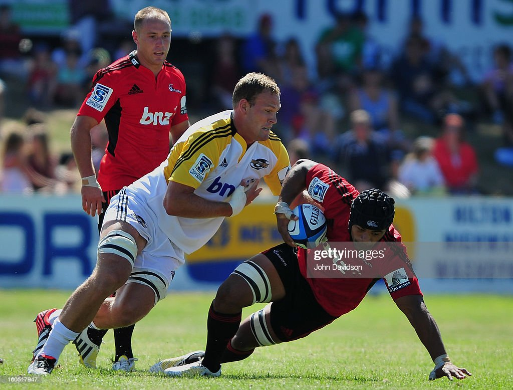 Jorden Taufua of the Crusaders is tackled by James Broadhurst of the Hurricanes during the 2013 Super Rugby pre-season friendly match between the Crusaders and the Hurricanes at Alpine Stadium on February 2, 2013 in Timaru, New Zealand.