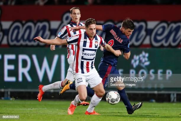 Jordens Peters of Willem II Klaas Jan Huntelaar of Ajax during the Dutch Eredivisie match between Willem II v Ajax at the Koning Willem II Stadium on...
