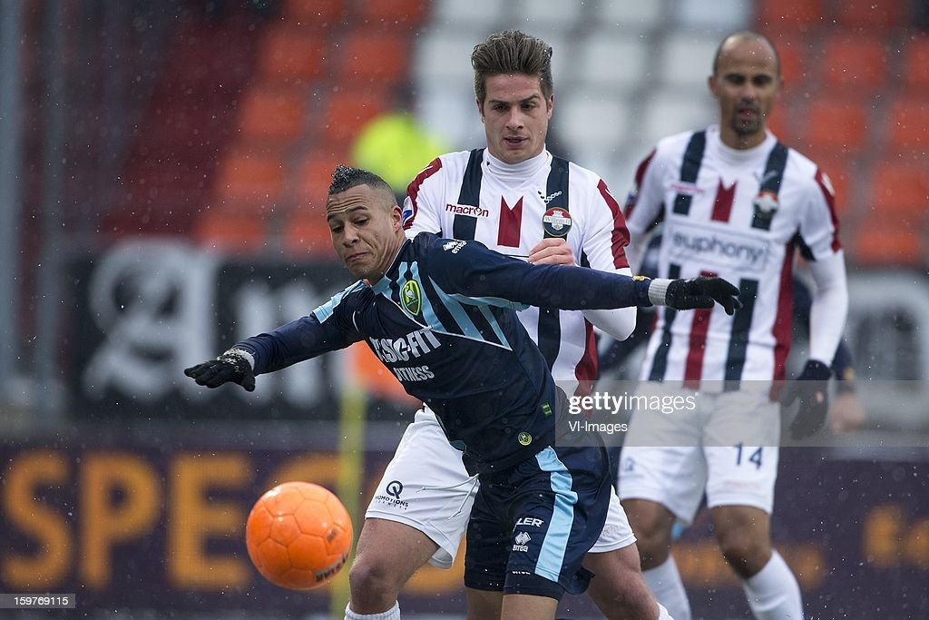 Jordens Peters of Willem II, Tjaronn Chery of ADO Den Haag during the Dutch Eredivise match between Willem II and ADO Den Haag at the Koning Willem II Stadium on January 20, 2013 in Tilburg, The Netherlands.