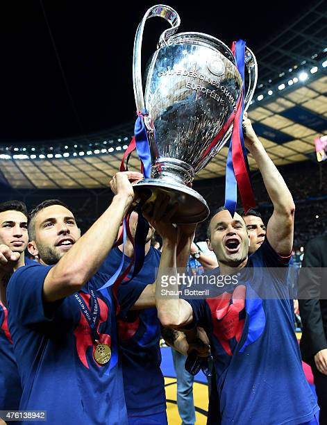 Jordi Alba and Andres Iniesta of Barcelona celebrate with the trophy after the UEFA Champions League Final between Juventus and FC Barcelona at...