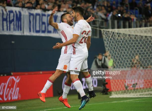 Jordi Alba and Asensio of Spain celebrate after scoring a goal during an international friendly football match between Russia and Spain at...