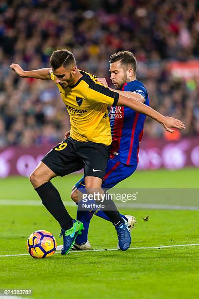 Jordi Alba and Javi Ontiveros during the match between FC Barcelona vs Malaga CF for the round 12 of the Liga Santander played at Camp Nou Stadium on...