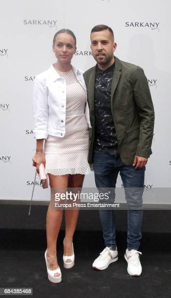 Jordi Alba and Romarey Ventura attend the opening of Sarkany Shoes Boutique on May 17 2017 in Barcelona Spain