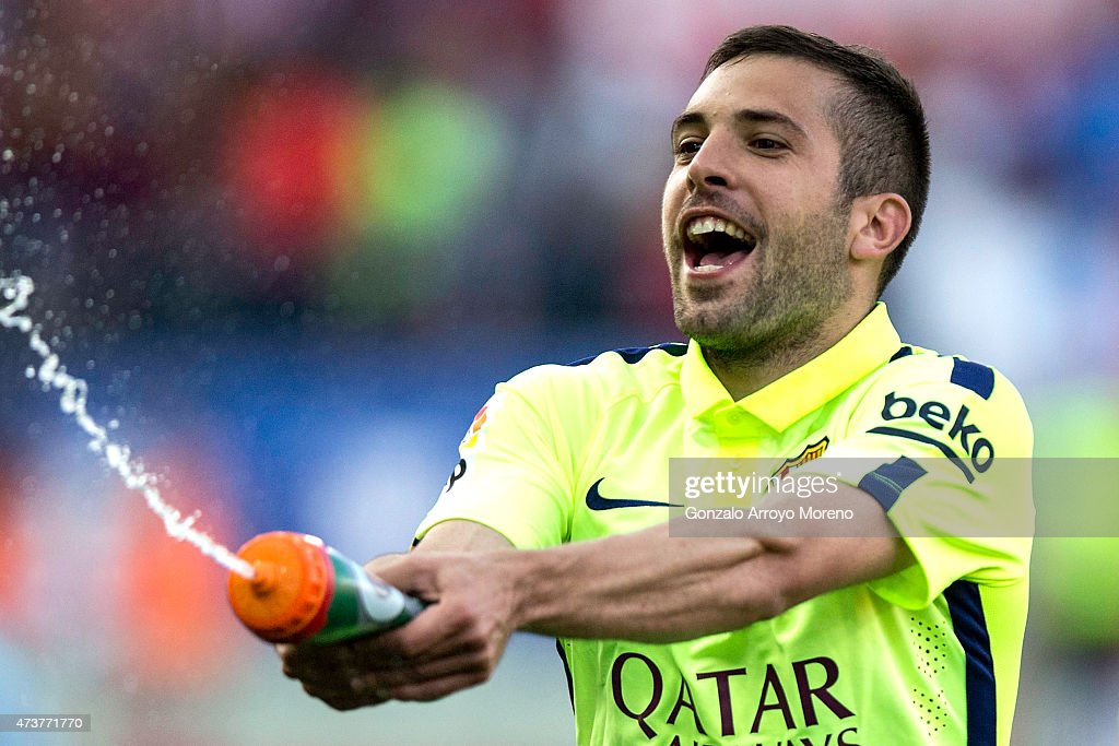 <a gi-track='captionPersonalityLinkClicked' href=/galleries/search?phrase=Jordi+Alba&family=editorial&specificpeople=5437949 ng-click='$event.stopPropagation()'>Jordi Alba</a> of Barcelona celebrates as they the title after the La Liga match between Club Atletico de Madrid and FC Barcelona at Vicente Calderon Stadium on May 17, 2015 in Madrid, Spain. Barcelona are champions after a 1-0 victory.