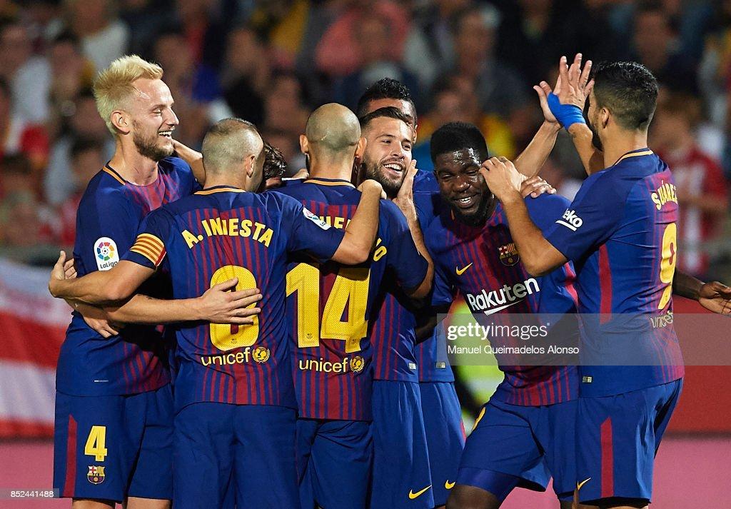 Jordi Alba of Barcelona celebrates scoring his team's first goal with his teammates during the La Liga match between Girona and Barcelona at Municipal de Montilivi Stadium on September 23, 2017 in Girona, Spain.