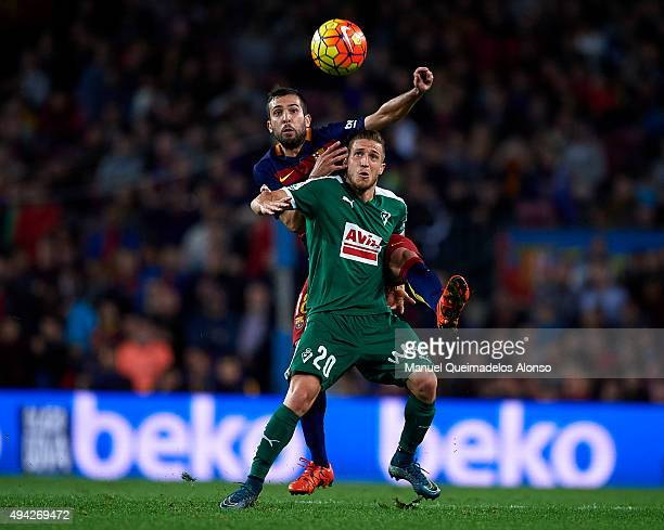 Jordi Alba of Barcelona competes for the ball with Keko of Eibar during the La Liga match between FC Barcelona and SD Eibar at Camp Nou Stadium on...