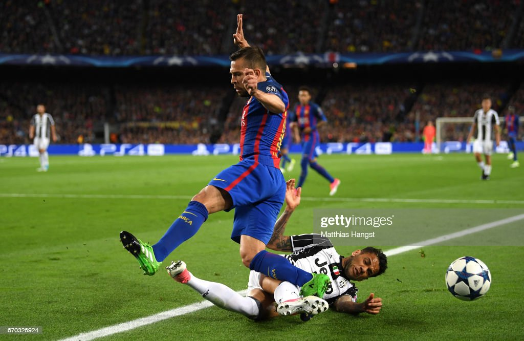 Jordi Alba of Barcelona is tackled by Dani Alves of Juventus during the UEFA Champions League Quarter Final second leg match between FC Barcelona and Juventus at Camp Nou on April 19, 2017 in Barcelona, Spain.