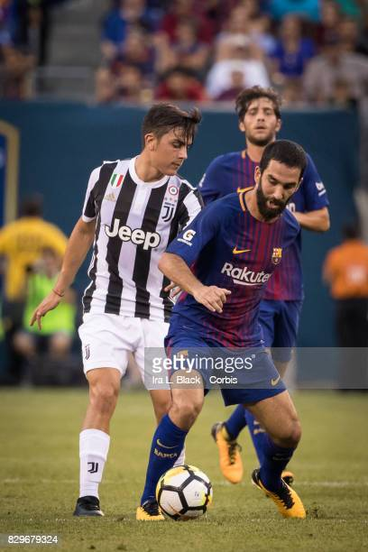 Jordi Alba of Barcelona takes control of the ball against Paulo Dybala of Juventus during the International Champions Cup match between FC Barcelona...