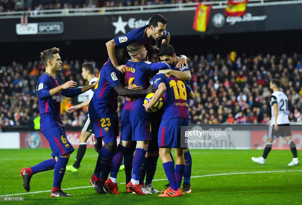 Jordi Alba of FC Barcelona (R) celebrates with hist team mates after scoring his team's first goal during the La Liga match between Valencia and Barcelona at Mestalla stadium on November 26, 2017 in Valencia, Spain.