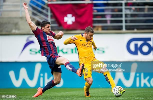 Jordi Alba of FC Barcelona duels for the ball with Ander Capa of SD Eibar during the La Liga match between SD Eibar and FC Barcelona at Ipurua...