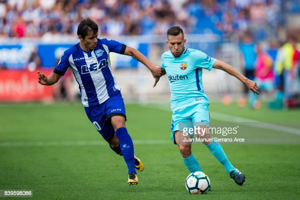 Jordi Alba of FC Barcelona duels for the ball with Oscar Romero of Deportivo Alaves during the La Liga match between Deportivo Alaves and Barcelona...