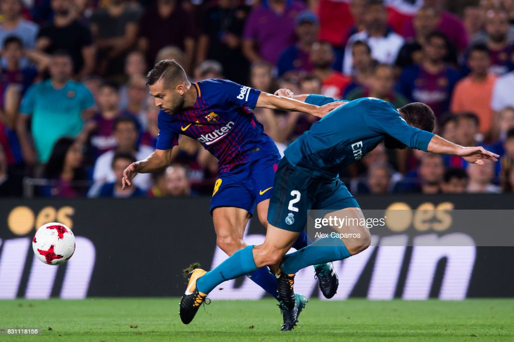 Jordi Alba (L) of FC Barcelona fights for the ball with Daniel Carvajal (R) of Real Madrid CF during the Supercopa de Espana Supercopa Final 1st Leg match between FC Barcelona and Real Madrid at Camp Nou on August 13, 2017 in Barcelona, Spain.