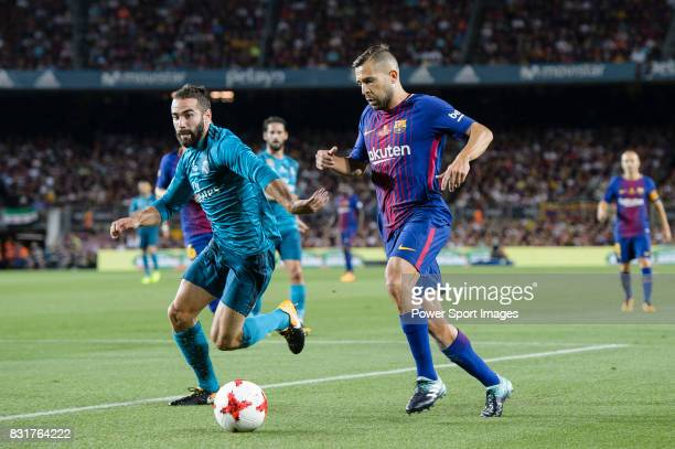Jordi Alba of FC Barcelona fights for the ball with Daniel Carvajal of Real Madrid during the Supercopa de Espana Final 1st Leg match between FC...