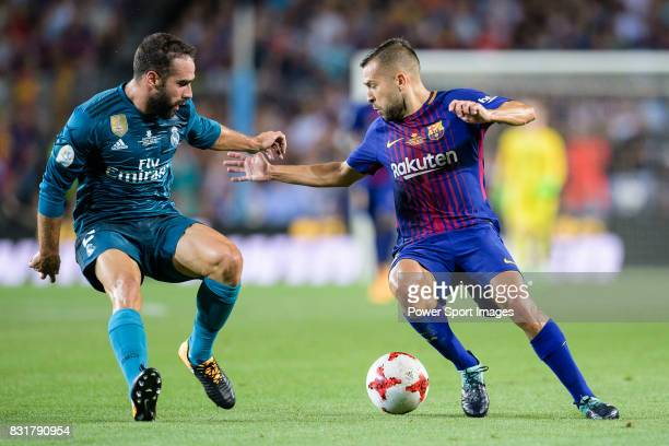 Jordi Alba of FC Barcelona in action against Daniel Carvajal of Real Madrid during the Supercopa de Espana Final 1st Leg match between FC Barcelona...