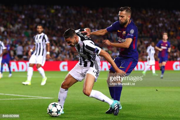 Jordi Alba of FC Barcelona in action with Mattia De Sciglio of Juventus during the UEFA Champions League Group D match between FC Barcelona and...