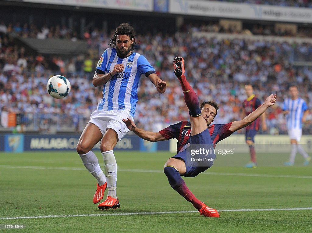 ;<a gi-track='captionPersonalityLinkClicked' href=/galleries/search?phrase=Jordi+Alba&family=editorial&specificpeople=5437949 ng-click='$event.stopPropagation()'>Jordi Alba</a> (R) of FC Barcelona tries an overhead kick beside Sergio Sanchez of Malaga CF during the La Liga match between Malaga CF and FC Barcelona at La Rosaleda Stadium on August 25, 2013 in Malaga, Spain.