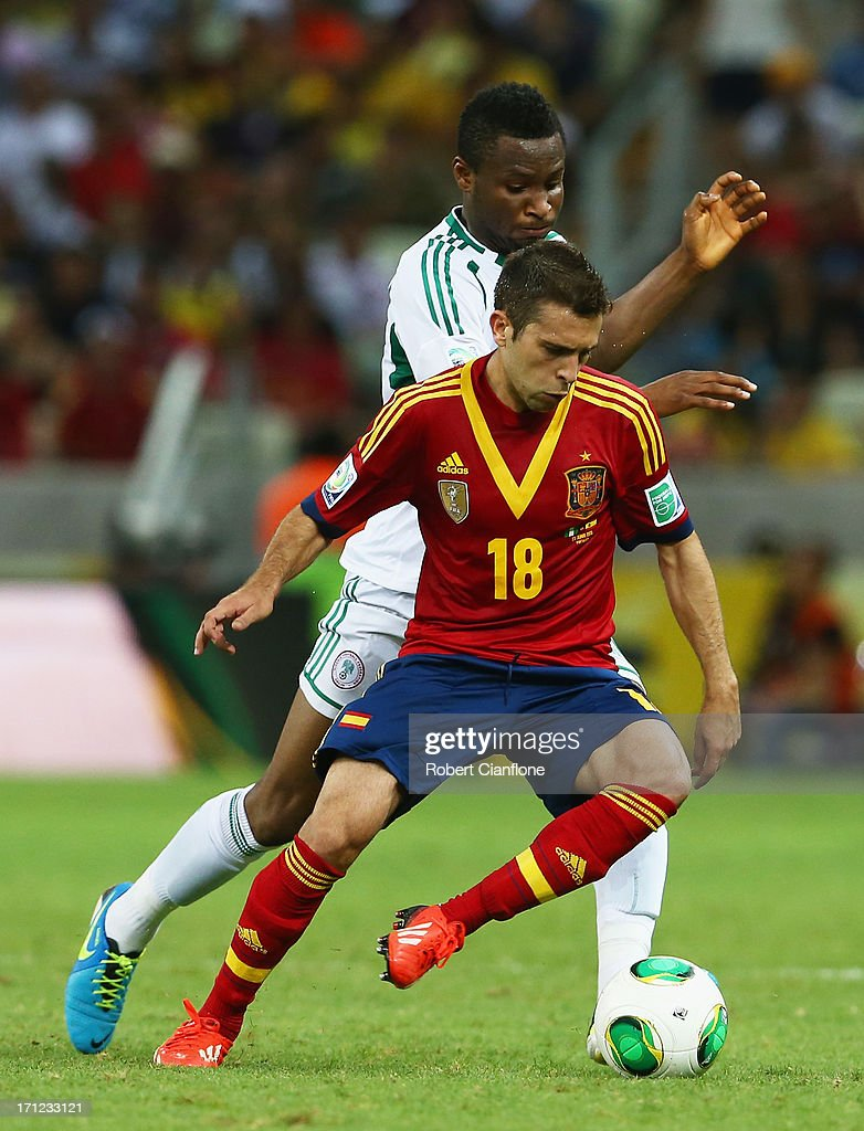 Jordi Alba of Spain battles for the ball with Mikel John Obi of Nigeria during the FIFA Confederations Cup Brazil 2013 Group B match between Nigeria and Spain at Castelao on June 23, 2013 in Fortaleza, Brazil.