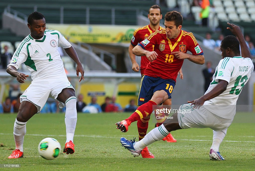 <a gi-track='captionPersonalityLinkClicked' href=/galleries/search?phrase=Jordi+Alba&family=editorial&specificpeople=5437949 ng-click='$event.stopPropagation()'>Jordi Alba</a> of Spain (18) beats the Nigeria defence to score their first goal during the FIFA Confederations Cup Brazil 2013 Group B match between Nigeria and Spain at Castelao on June 23, 2013 in Fortaleza, Brazil.