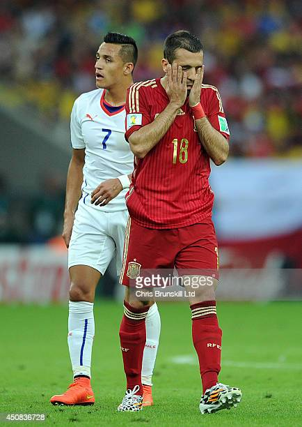 Jordi Alba of Spain reacts during the 2014 FIFA World Cup Brazil Group B match between Spain and Chile at Maracana Stadium on June 18 2014 in Rio de...