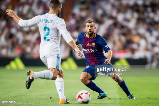 MADRID SPAIN AUGUST 16 Jordi Alba Ramos of FC Barcelona tries to tackle Daniel Carvajal Ramos of Real Madrid during their Supercopa de Espana Final...