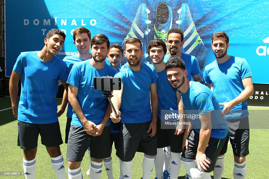 <a gi-track='captionPersonalityLinkClicked' href=/galleries/search?phrase=Jordi+Alba&family=editorial&specificpeople=5437949 ng-click='$event.stopPropagation()'>Jordi Alba</a> (C) takes a group selfie with an iPhone 6 with Adidas' supporters during the Adidas Boots X15 presentation at Futbolmania store on May 4, 2016 in Barcelona, Spain.