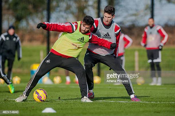 Jordi Amat and Federico Fernandez of Swansea City go for the ball during training on January 28 2015 in Swansea Wales