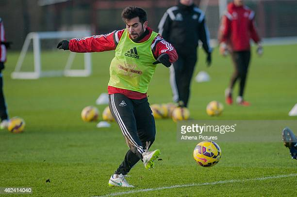 Jordi Amat kicks the ball forwards during training on January 28 2015 in Swansea Wales