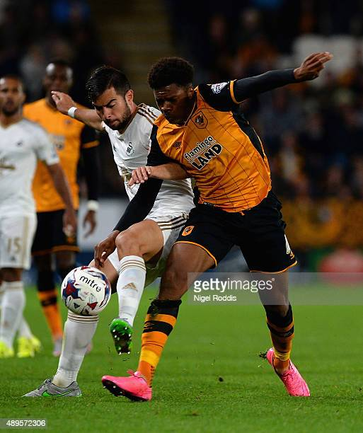 Jordi Amat of Swansea City and Chuba Akpom of Hull City tussle for the ball during the Capital One Cup third round match between Hull City and...