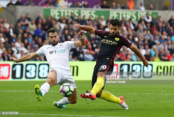 Jordi Amat of Swansea City attempts to block Sergio Aguero of Manchester City shot during the Premier League match between Swansea City and...