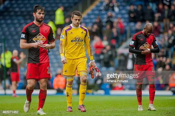 Jordi Amat of Swansea City Lukasz Fabianski of Swansea City and Dwight Tiendalli of Swansea City leave the field with their heads down during the FA...