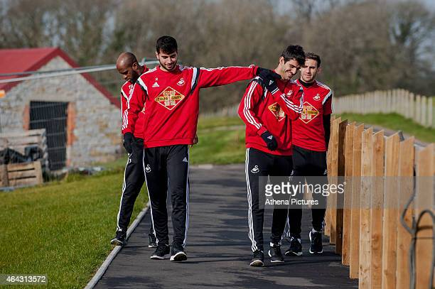 Jordi Amat plays around with Nelson Oliveira of Swansea City prior to the the Swansea City training session on February 24 2015 in Swansea Wales