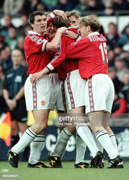 FEATURE Jordi Cruyff is mobbed by Manchaester United teammates after scoring the equalizer against Derby during the Premiership clash between Derby v...