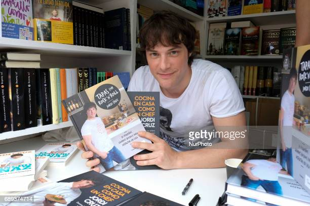Jordi Cruz signs books during the book fair in Madrid held from May 26 to July 11 2017 in Retiro Park in Madrid Spain May 28 2017