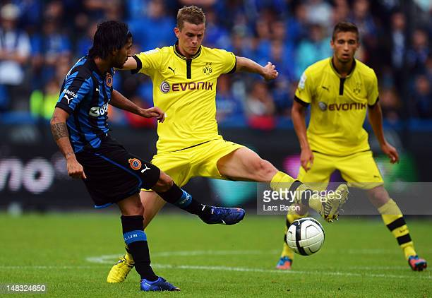 Jordi Figueras of Brugge is challenged by Sven Bender of Dortmund during a friendly match between Club Brugge KV and Borussia Dortmund at Jan Breydel...