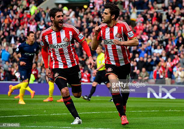Jordi Gomez of Sunderland celebrates scoring his penalty with Danny Graham during the Barclays Premier League match between Sunderland and...