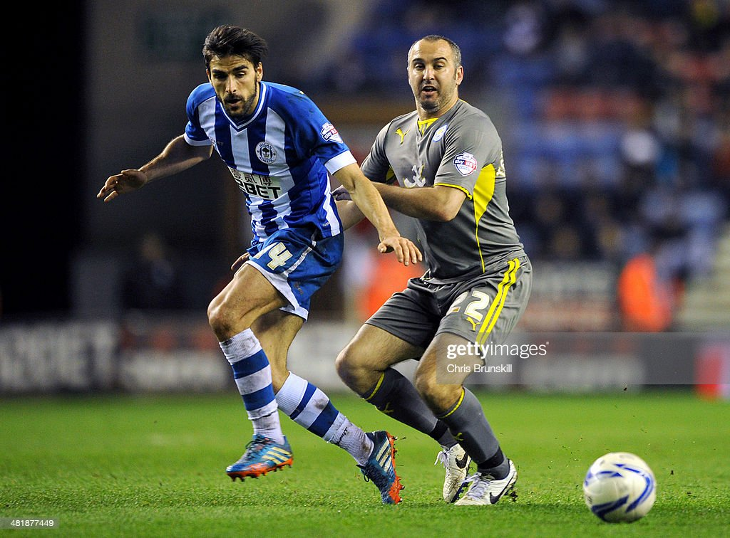 <a gi-track='captionPersonalityLinkClicked' href=/galleries/search?phrase=Jordi+Gomez&family=editorial&specificpeople=1323748 ng-click='$event.stopPropagation()'>Jordi Gomez</a> (L) of Wigan Athletic in action with Gary Taylor-Fletcher of Leicester City during the Sky Bet Championship match between Wigan Athletic and Leicester City at DW Stadium on April 01, 2014 in Wigan, England.